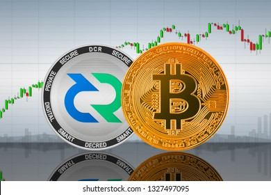 Bitcoin (BTC) and Decred (DCR) coins on the background of the chart; bitcoin and decred cryptocurrency; crypto exchange. 3d illustration