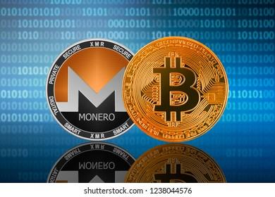 Bitcoin (BTC) and Monero (XMR) coin on the binary code background; bitcoin vs monero