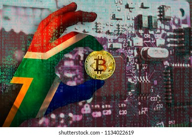 Bitcoin crypto currency South Africa flag Binary code Golden Coin of Bitcoin in the african flag hand between two fingers shows OK sign chip background matrix effect Business mining graphics card