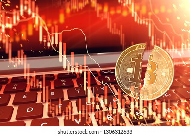 Bitcoin split in two pieces on keyboard. Bitcoin stock-market price plummets concept. 3D rendering