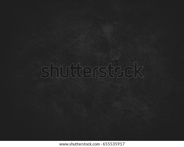 Black abstract background with spots and scratches