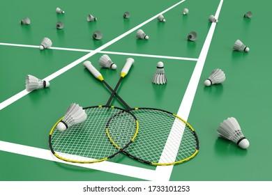 Black badminton rackets on a green floor in badminton court. 3d illustration