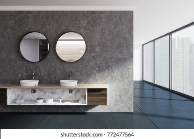 Black bathroom interior with a concrete floor, a panoramic window, a double sink and two round mirrors. 3d rendering mock up