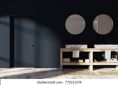 Black bathroom interior with a white marble floor, a double sink next to a closed door and round mirrors. 3d rendering mock up