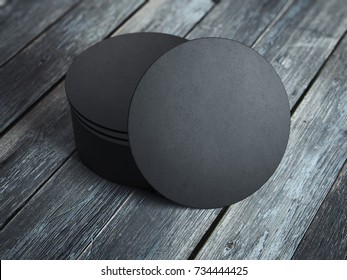 Black beverage coasters on the wooden floor. 3d rendering