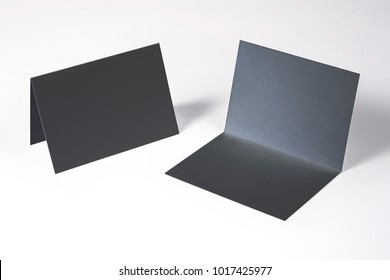 Black bi-fold invitation, greeting cards isolated on white to showcase your event presentation. 3d illustration.
