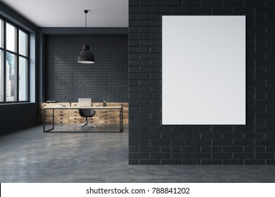 Black brick CEO office interior with a concrete floor, a large table with a computer on it and a poster. 3d rendering mock up