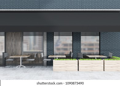 Black brick and dark wood restaurant exterior with square tables and gray chairs standing outside. A flowerbed. 3d rendering mock up