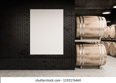 Black brick wine cellar with a concrete floor, rows of wooden kegs, and a vertical mock up poster. 3d rendering