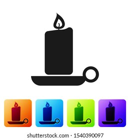 Black Burning candle in candlestick icon on white background. Old fashioned lit candle. Cylindrical aromatic candle stick with burning flame. Set icon in color square buttons