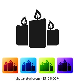 Black Burning candles icon isolated on white background. Old fashioned lit candles. Cylindrical aromatic candle sticks with burning flames. Set icon in color square buttons