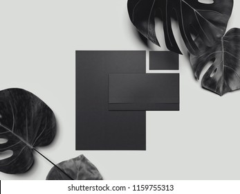Black business stationery mock-up, template for branding identity with tropical flowers on gray background. 3D rendering.