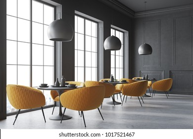 Black cafe corner with a concrete floor, round black tables and yellow chairs. 3d rendering mock up