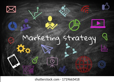 Black chalkboard with marketing strategy and icons