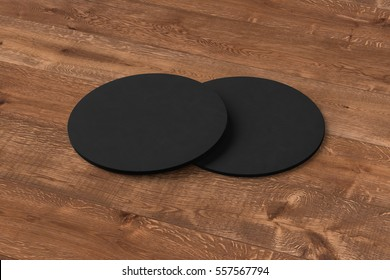 Black coasters. Isolated on wooden background. Include clipping path. 3d render