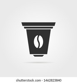 black coffee capsule icon with shadow. concept of kitchen item for percolator or electric coffee maker. simple flat style trend modern logo graphic art design isolated on gray background