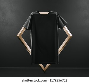 Black color t-shirt Mockup on a creative golden hanger on black background. 3D rendering