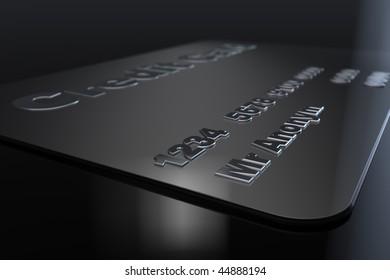 Black credit card lying on black floor