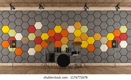 Black drums in a recording studio with colorful acoustic panel and speakers - 3d rendering