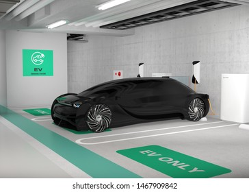 Black electric car charging in charging station locate in underground  parking lot. 3D rendering image.