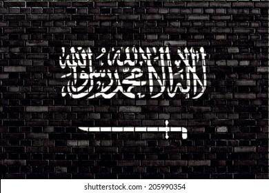 Black flag of Jihad painted on brick wall