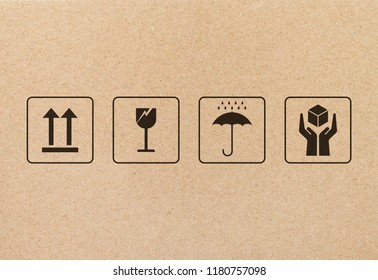 Black fragile sign and symbol on brown cardboard paper. Fragile symbol illustration graphic.
