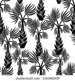Black hand drawn palm trees isolated on white background. Seamless pattern in cartoon style. Perfect for fabric, wallpaper or giftwrap.