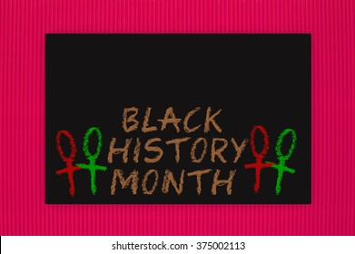 Black History Month Blackboard hanging on red textured background pattern