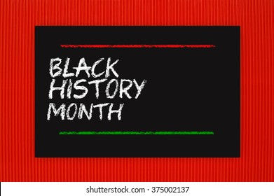 Black History Month Blackboard hanging on red textured background