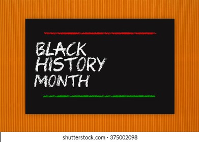 Black History Month Blackboard sign hanging on orange textured background