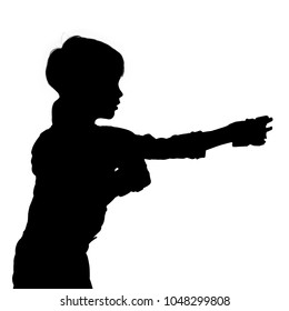 Black imageof young boy practicing martial arts. the silhouette is made from a photograph