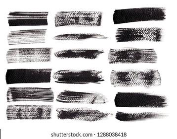 Black ink grunge brush set strokes on white background.