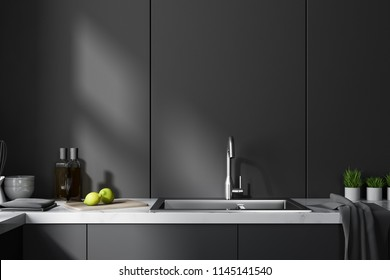 Black kitchen countertops with built in appliances near a black panel wall. Close up. Concept of interior design. 3d rendering mock up