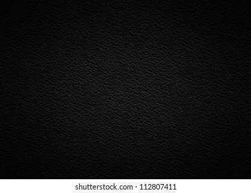 Black leather background.
