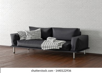 Black leather couch in interior of living room with wooden flooring and white brick wall. 3d illustration