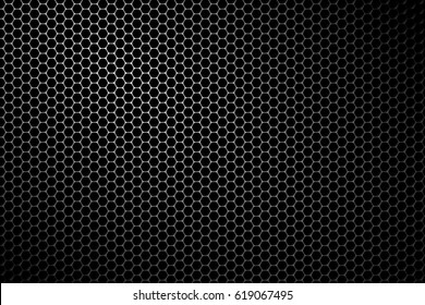 Black metal speaker mesh background. Metallic texture or pattern with hexagonal holes.
