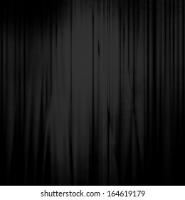 black movie or theatre curtain with some soft folds in it