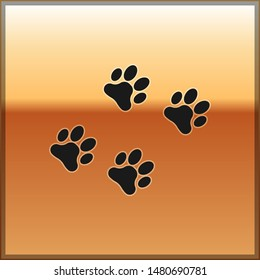 Black Paw print icon isolated on gold background. Dog or cat paw print. Animal track