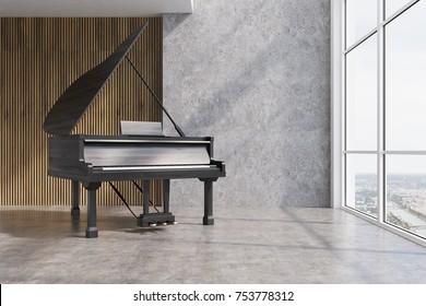 Black piano in a concrete and wooden room