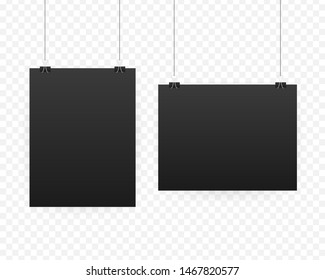 Black poster hanging on binder. Grey wall with mock up empty paper blank. Layout mockup. Vertical template sheet
