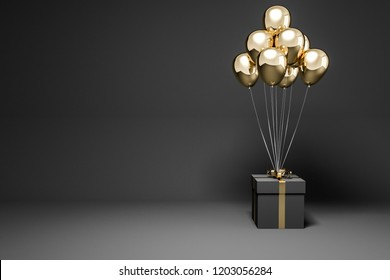 Black present box with gold ribbon and many gold balloons tied to it standing in empty black room. Concept of marketing and advertising. 3d rendering mock up