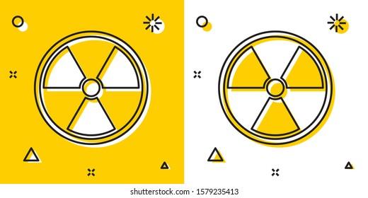 Black Radioactive icon isolated on yellow and white background. Radioactive toxic symbol. Radiation Hazard sign. Random dynamic shapes.