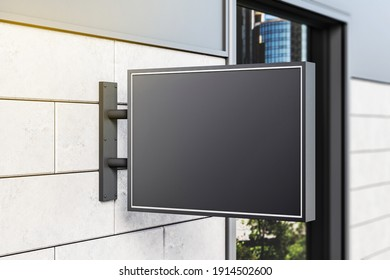 Black rectangular sign on wall of a modern shopping mall. Mock up. 3D Rendering
