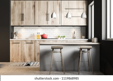 Black Scandinavian style kitchen interior with blue tiled and white walls, a wooden floor, wooden countertops and cabinets and a bar with stools. 3d rendering mock up