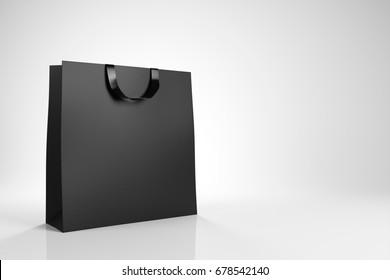 769750dd76 Black shopping bag on white background. Advertising and branding. 3d  rendering
