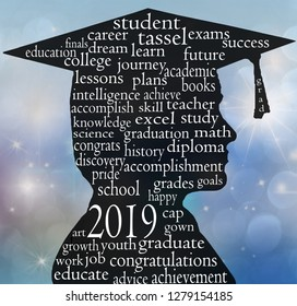 black silhouette of boy graduate with word cloud on blue bokeh background for 2019 graduation