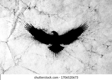 Black silhouette of a flying eagle with spread wings with paint splashes, splatters and blots on an old grunge vintage paper texture background.