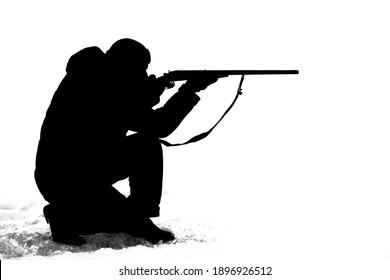 black silhouette of a man firing a gun
