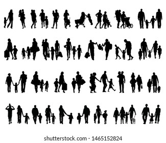 Black silhouettes of families in walking on a white background