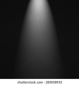 black spotlight background with white light. Product display image.